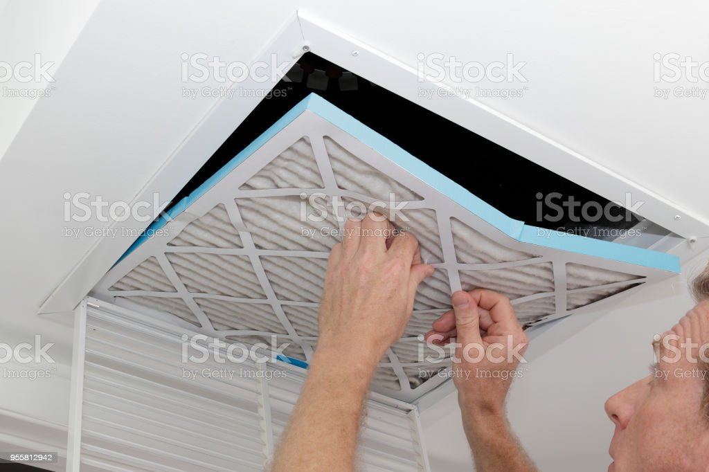 Man Removing Dirty Air Filter stock photo
