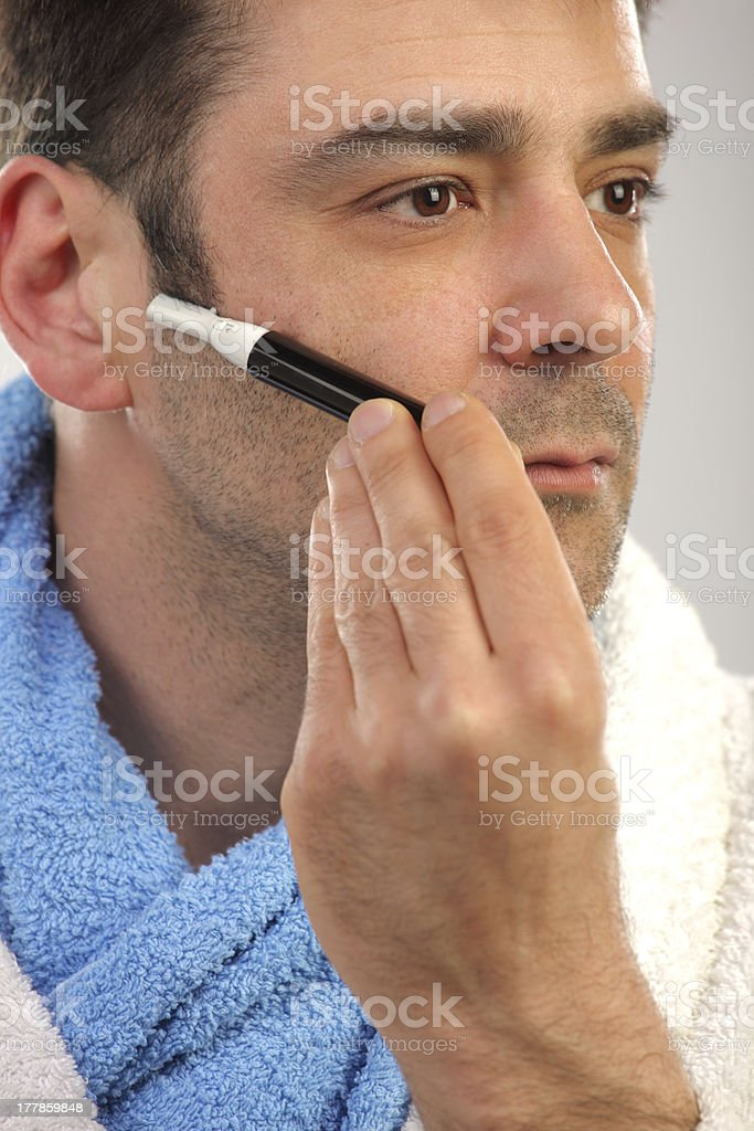 Man removing hair from his face stock photo