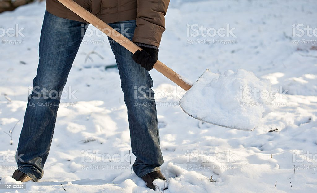 Man removing snow from a driveway royalty-free stock photo