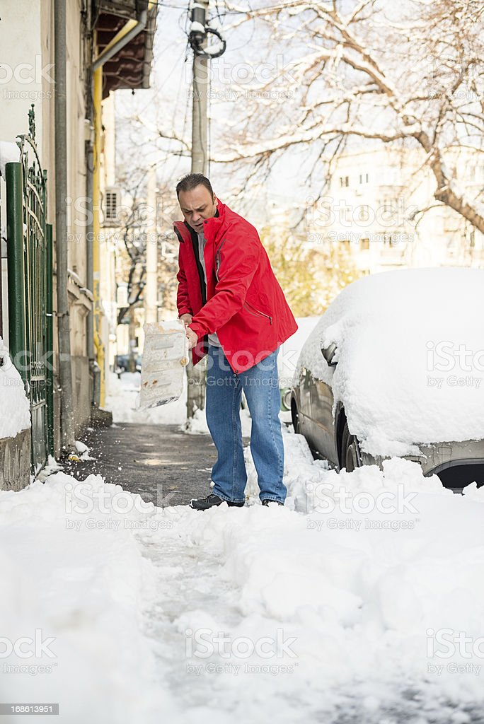 Man removing snow royalty-free stock photo