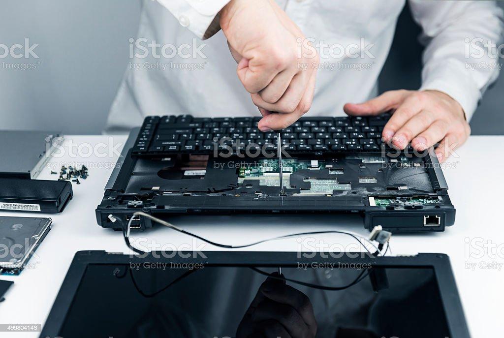 man repair laptop stock photo