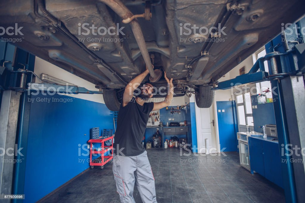 Man repairing a car stock photo