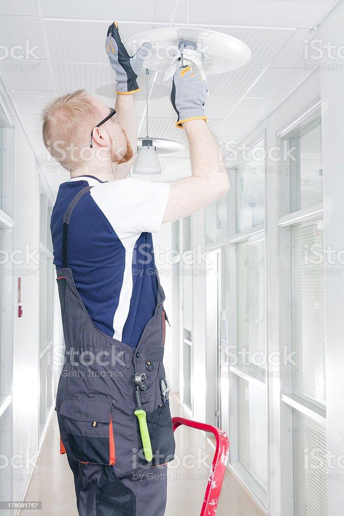 Man Repairing Broken Light stock photo