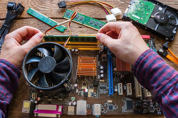 man repairing computer hardware ストックフォト
