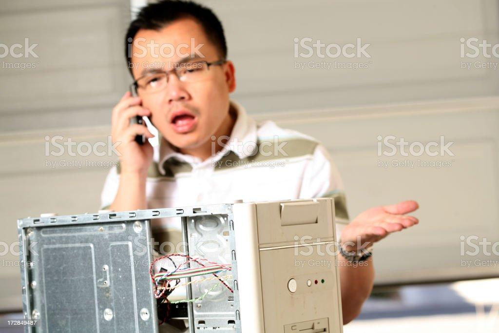 Man repairing computer royalty-free stock photo