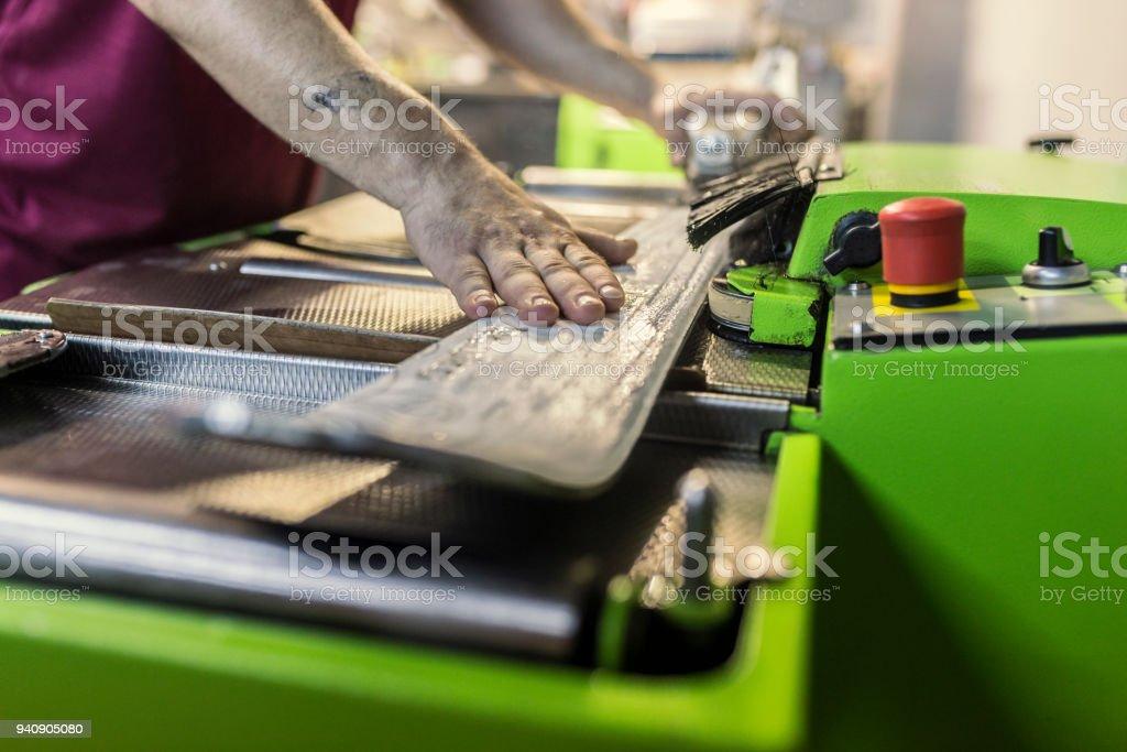 Man repairing sky in workshop stock photo