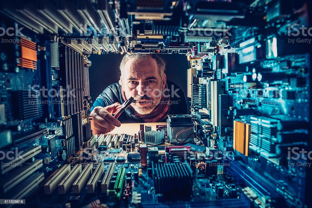 Man Repairing the Electronics, Technology Concept stock photo