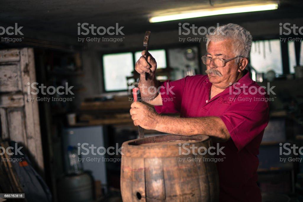 Man repairing wooden barrel royalty-free stock photo