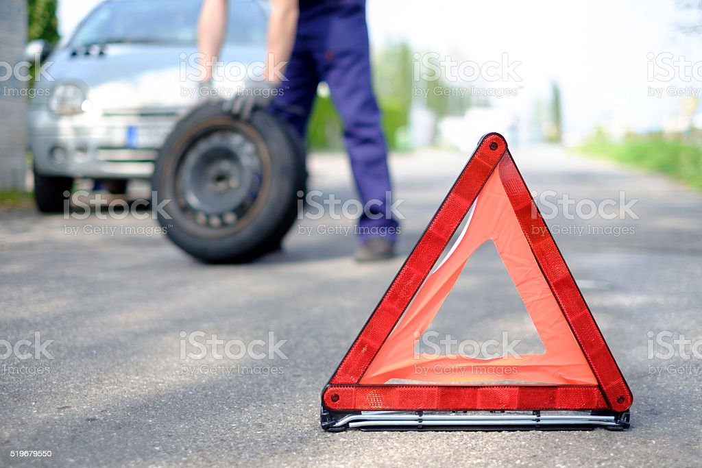 man repairs a car on the road stock photo