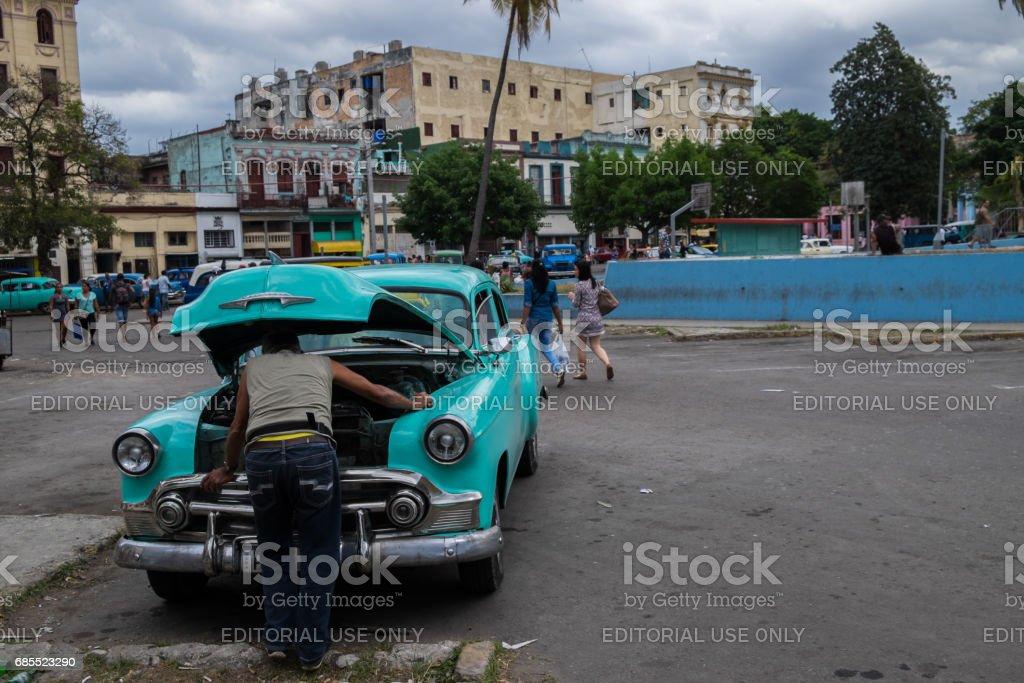 Man reparing an Old Car in Havana, Cuba stock photo