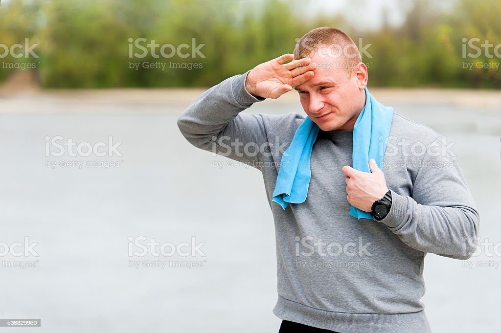 Man resting after run. Outdoor jogger. stock photo