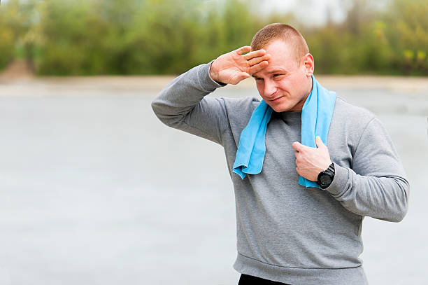 Man resting after run. Outdoor jogger. stock photo