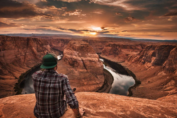 man resting at horseshoe bend in usa man resting at horseshoe bend in usa colorado river stock pictures, royalty-free photos & images