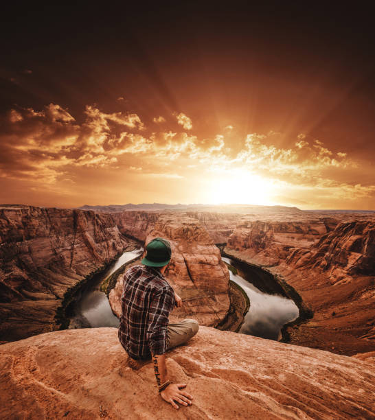 man resting at horseshoe bend in usa man resting at horseshoe bend in usa horseshoe bend colorado river stock pictures, royalty-free photos & images