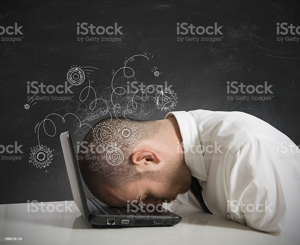 Man resting head on laptop stock photo