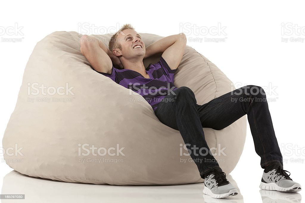 Man resting in a bean bag stock photo