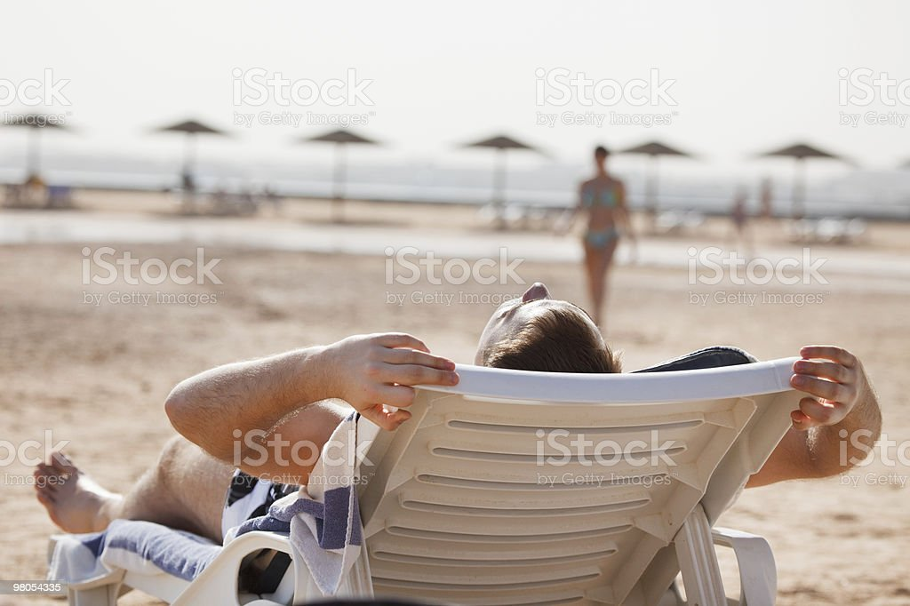 Man resting in beach chair royalty-free stock photo