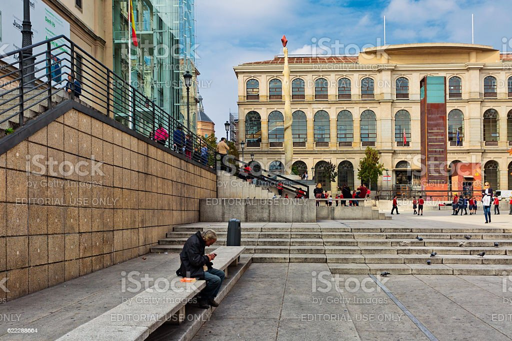 man resting in front of the Reina Sofia Museum, Madrid
