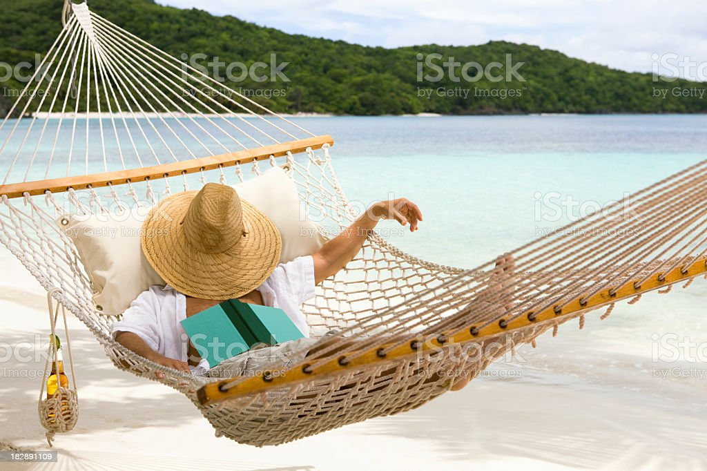 man resting in hammock at the Caribbean beach royalty-free stock photo