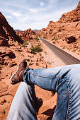 man resting in the valley of fire state park road