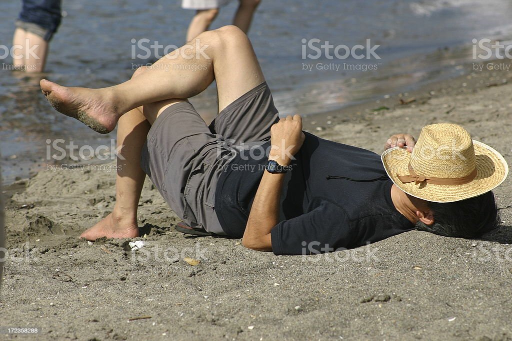 Man resting on the beach royalty-free stock photo