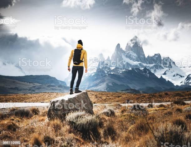 Photo of man resting on the rock in el chalten
