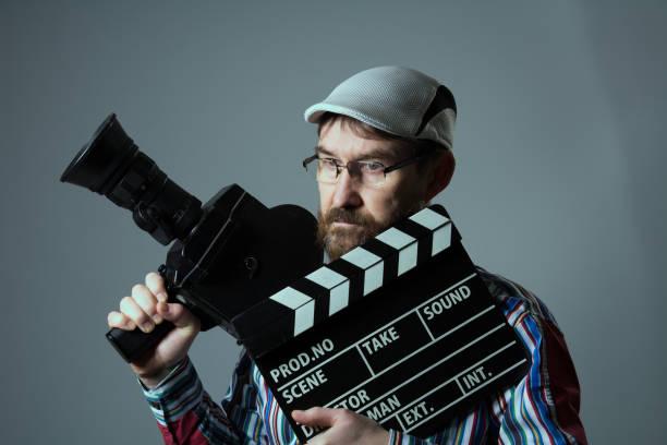 Man Retro movie camera and clapper stock photo