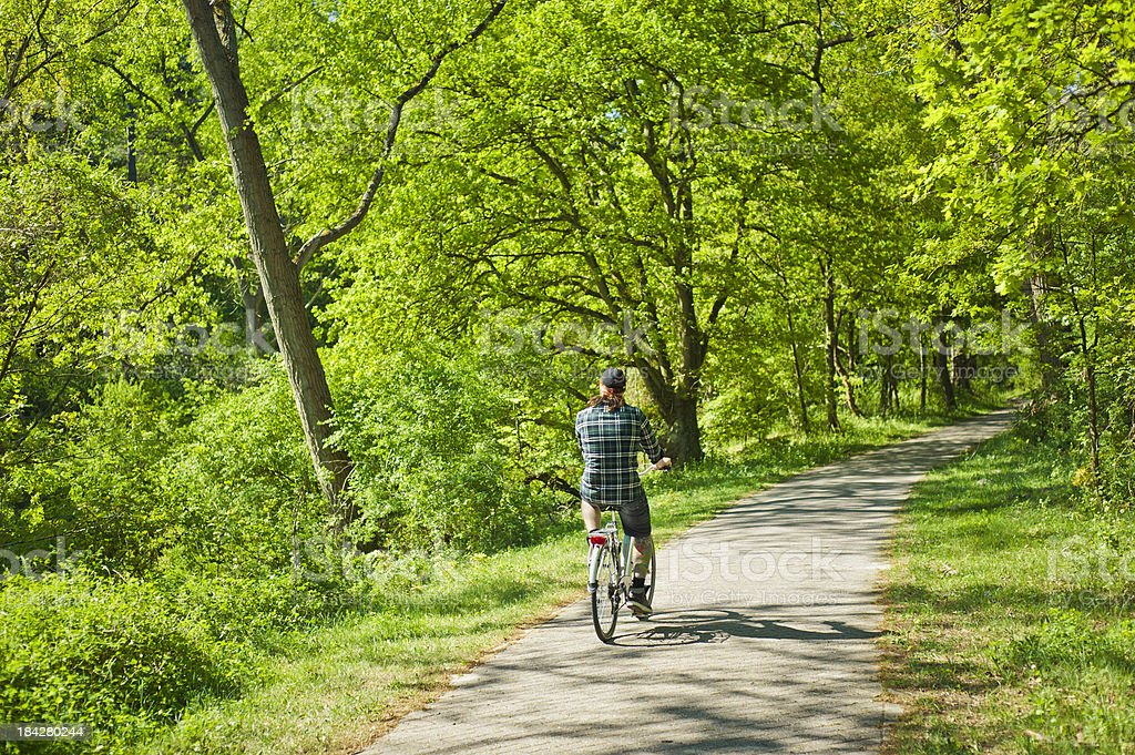 Man Rides A Bicycle In The Country, Netherlands stock photo