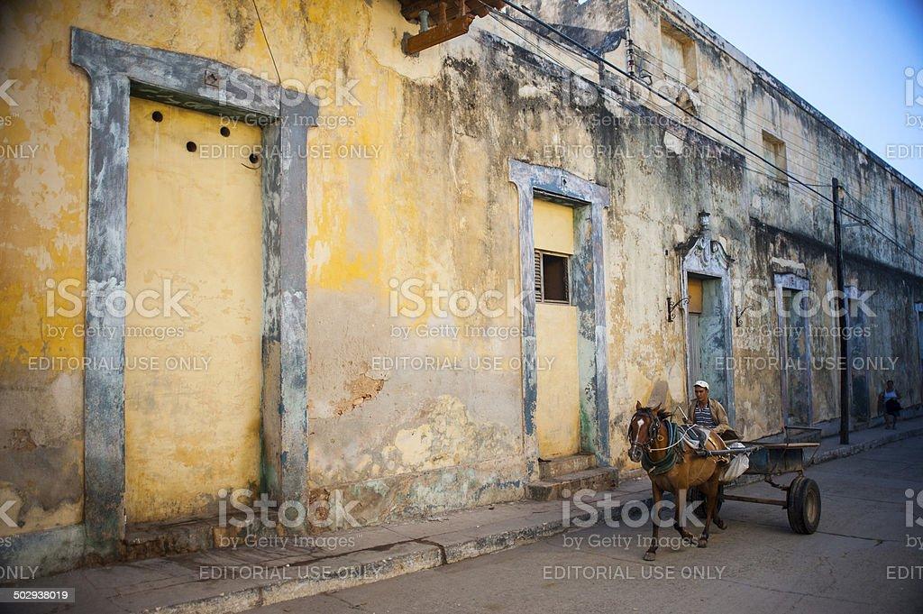 Man rides a horse cart in Cuba stock photo