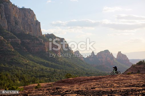 A man rides his mountain bike on a popular trail in Sedona, Arizona, USA.