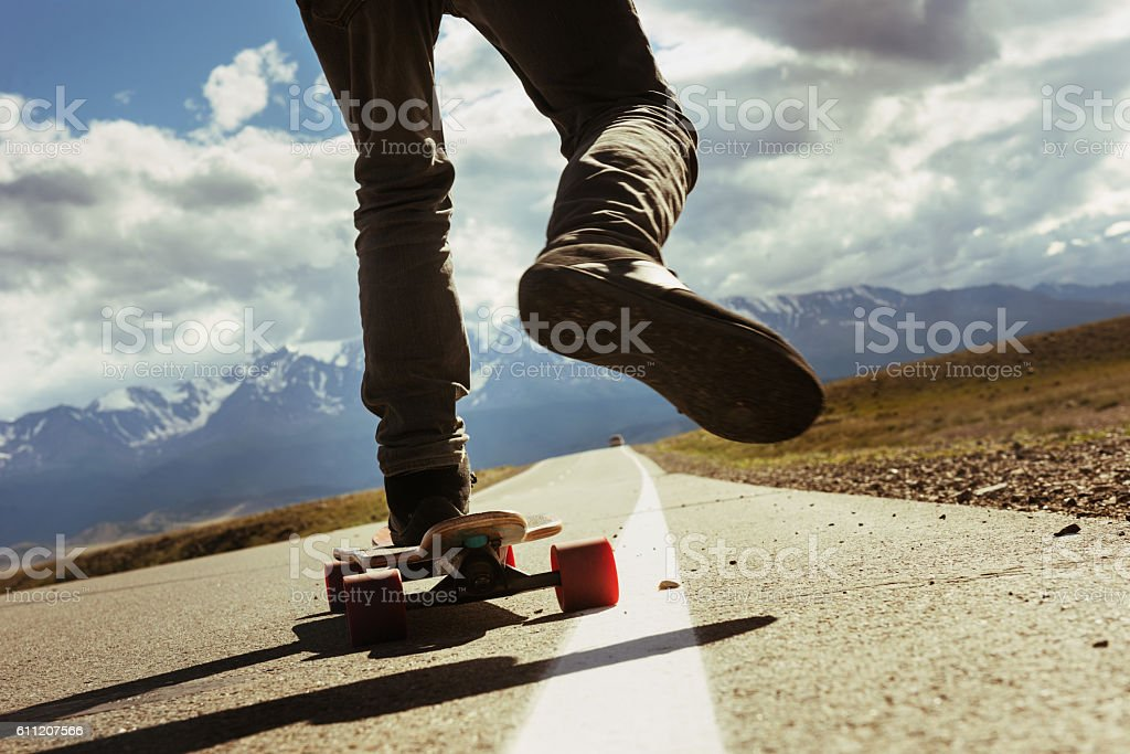 Man rides on the long board. Travel concept stock photo