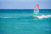 Pomorie, Burgas / Bulgaria -08.01.2020:Man athlete rides the windsurf over the waves on sea