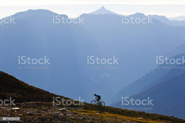 Photo of A man rides up a steep mountain bike trail in British Columbia, Canada.