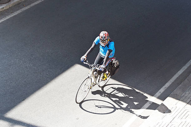Man riding a bicycle in the city stock photo