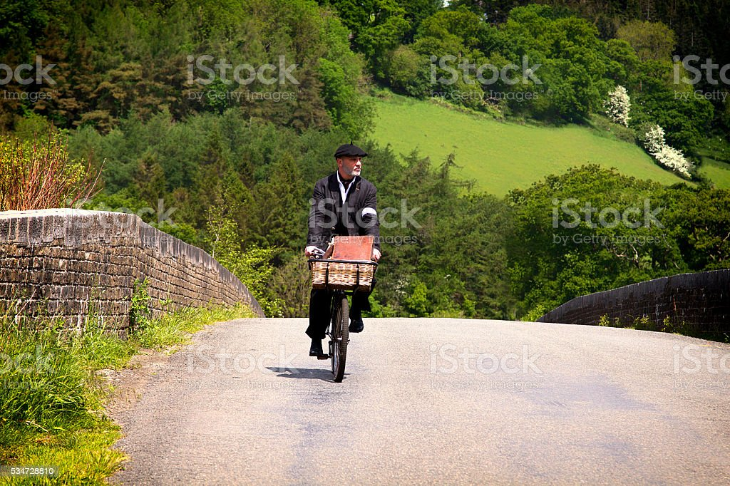 Man riding a bicycle in the countryside stock photo