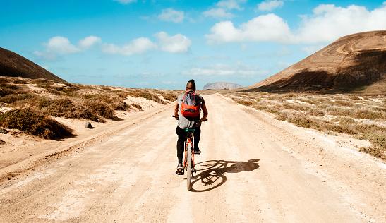 man riding a bike in La Graciosa, Canary Islands, Spain