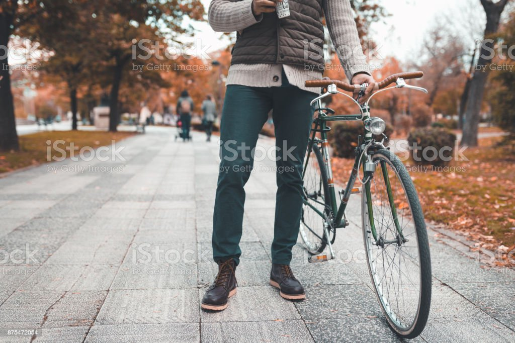 Man riding a bike  in the city on a beautiful autumn day stock photo