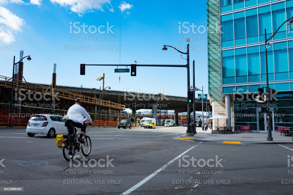 Man Riding A Bike On A City Street stock photo
