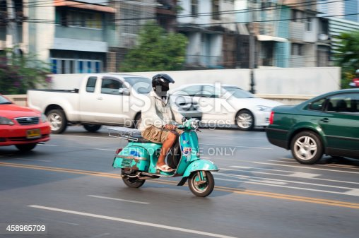 istock Man Riding A Classic Vespa Scooter 458965709