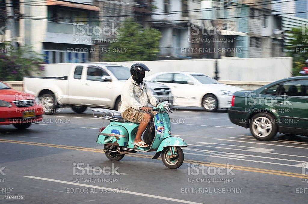 Man Riding A Classic Vespa Scooter stock photo