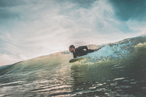 Man riding a wave on his bodyboard