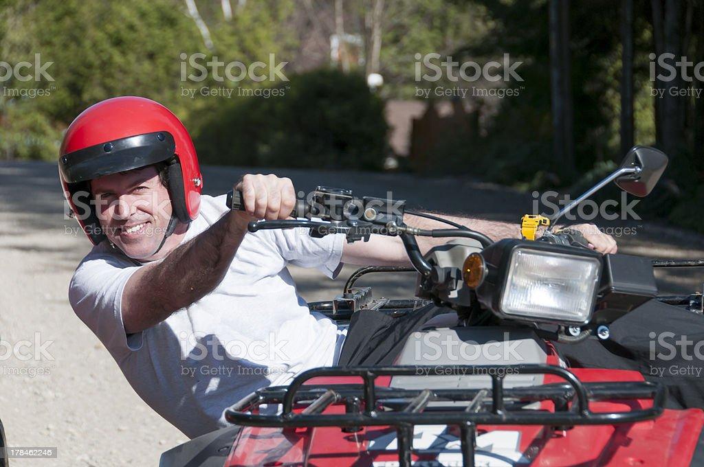 man riding an ATV stock photo