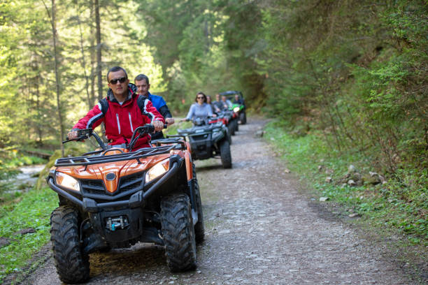 man riding atv vehicle on off road track ,people outdoor sport activities theme stock photo