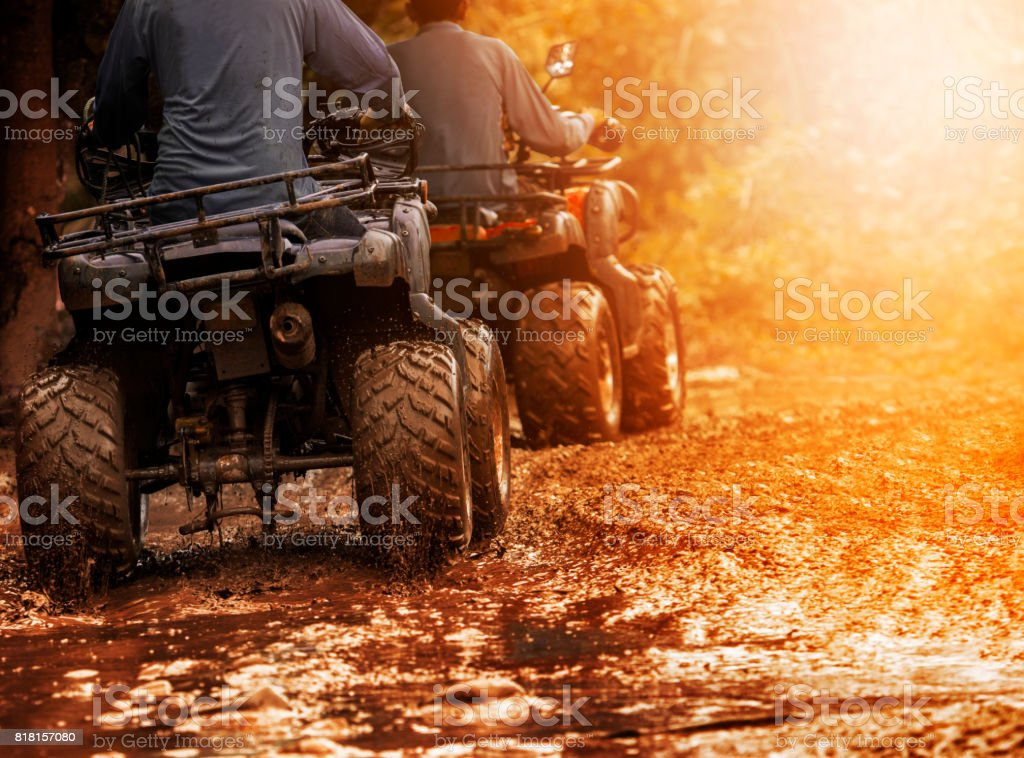 man riding atv vehicle on off road track ,people outdoor sport...