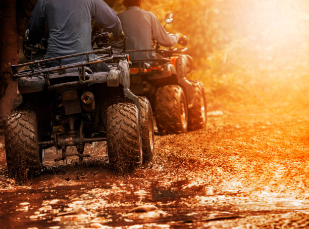man riding atv vehicle on off road track ,people outdoor sport activitiies theme man riding atv vehicle on off road track ,people outdoor sport activitiies theme quadbike stock pictures, royalty-free photos & images
