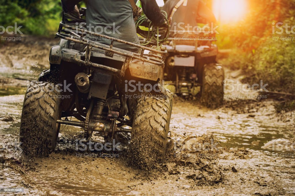 man riding atv vehicle on off road track ,people outdoor sport activitiies theme stock photo