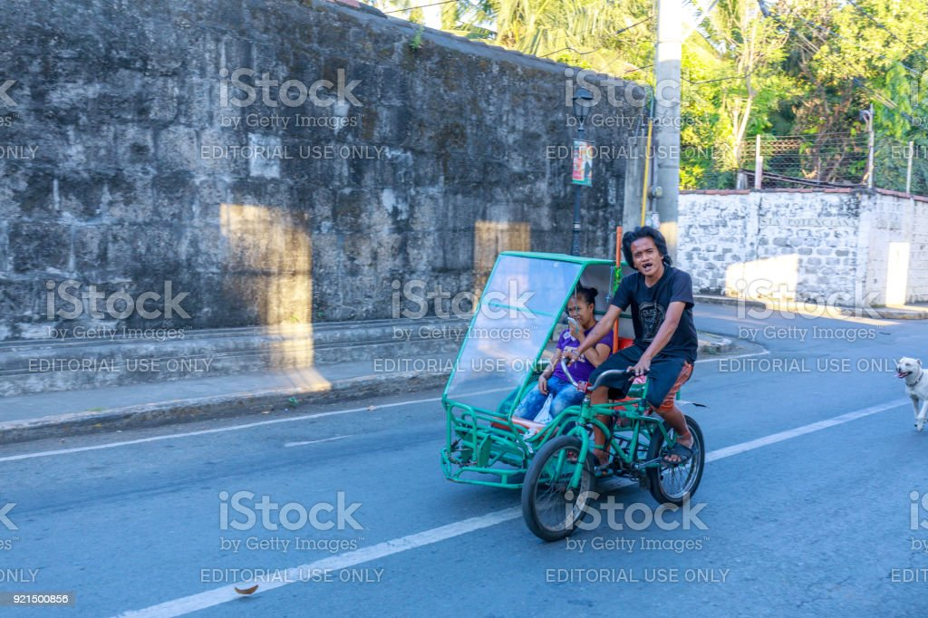 A man riding bicycle at Intramuros district, Manila city stock photo