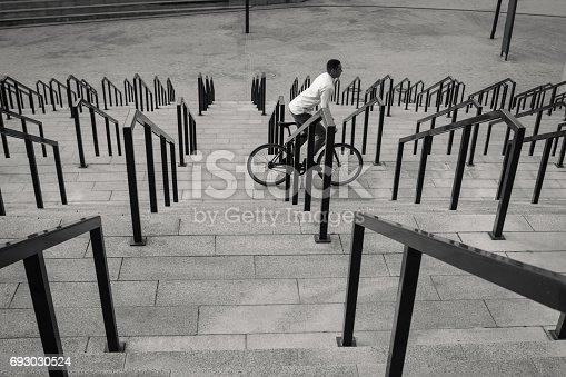 812812808istockphoto Man riding bicycle 693030524