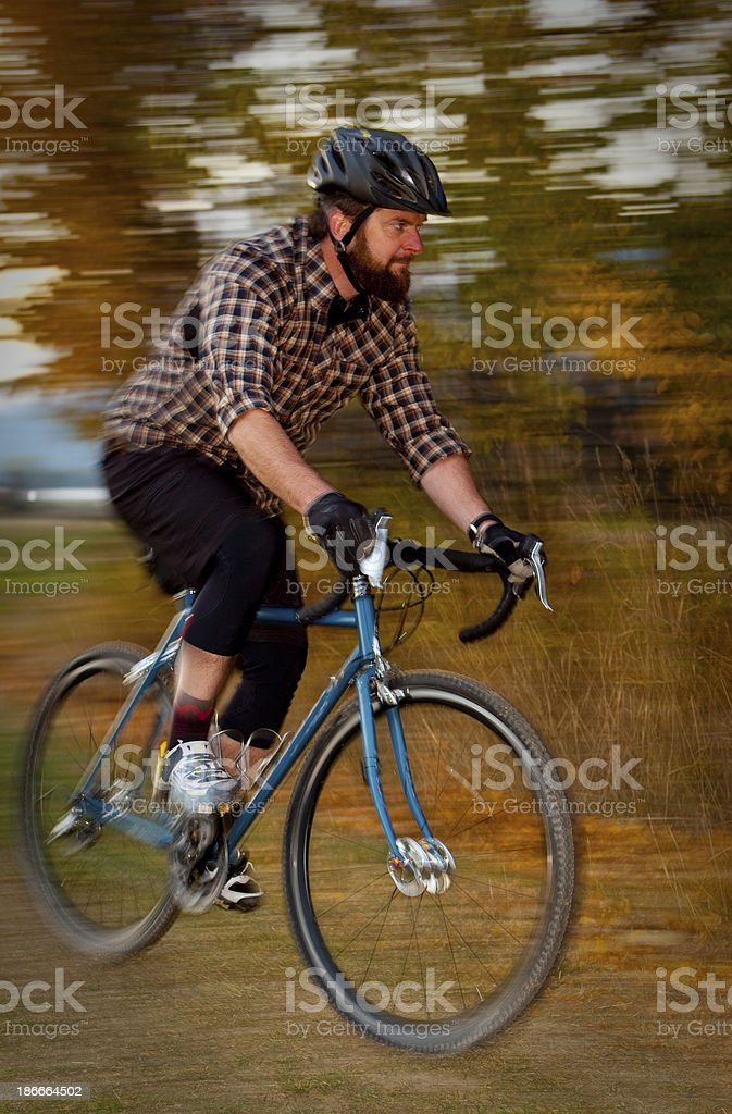 Man riding his cyclocross bike on a course. royalty-free stock photo