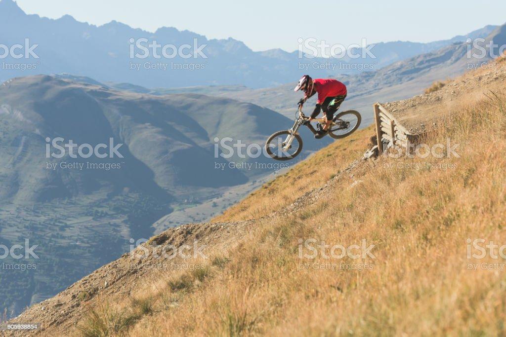 Man riding mountain bike downhill singletrack in Les Deux Alps stock photo